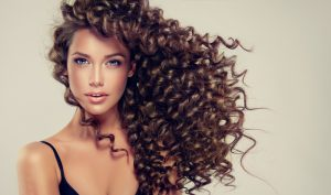 Brunette,Girl,With,Long,And,Shiny,Curly,Hair,.,Beautiful